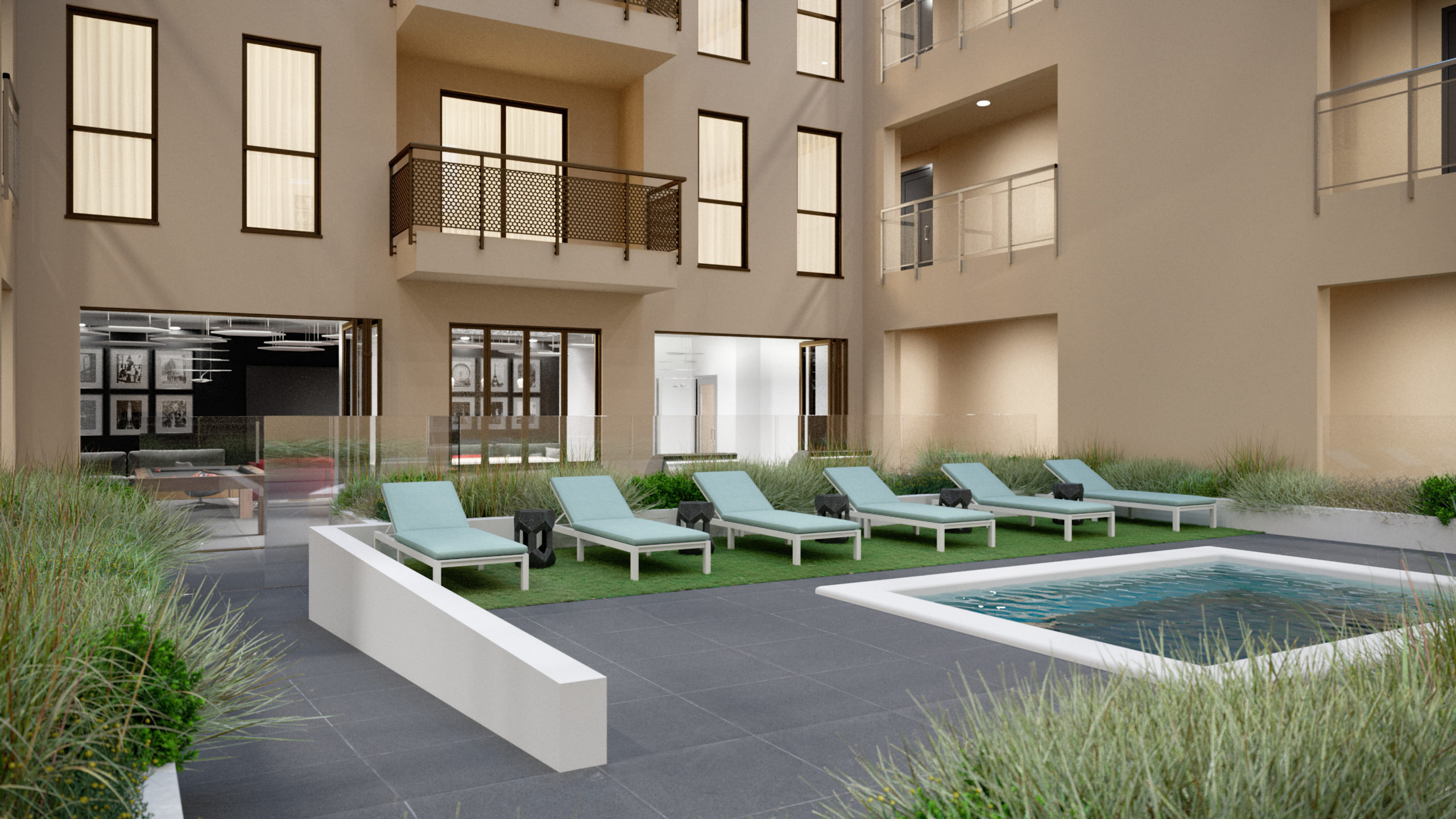 outdoor deck area with spa, gardens, balconies, and sun bathing beds